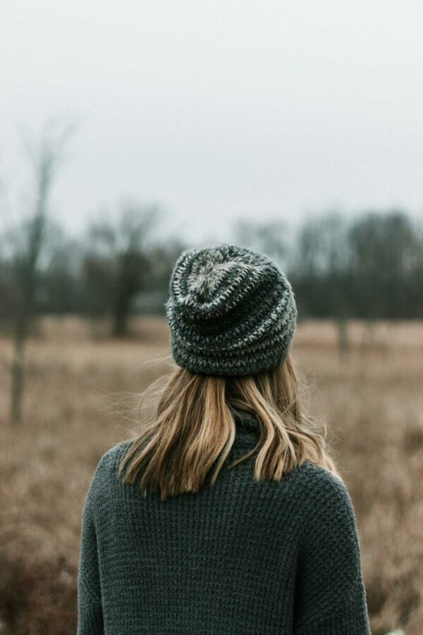 woman in black knit cap and gray knit sweater