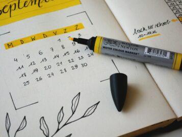 black marker on notebook